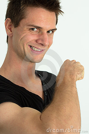 Man showing he s arm muscles