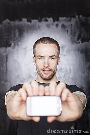 Man showing screen of smartphone, focus on guy