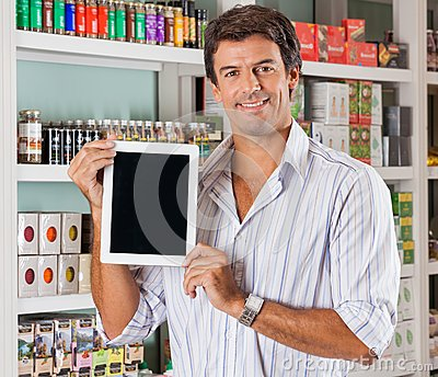 Man Showing Tablet In Grocery Store