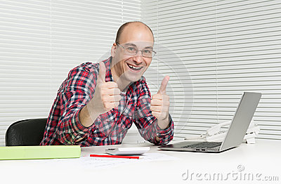 Man showing thumbs up in office