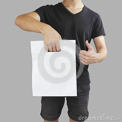 Free Man Shows Blank Plastic Bag Mock Up And Thumb Up Isolated. Empty Royalty Free Stock Photography - 76784237