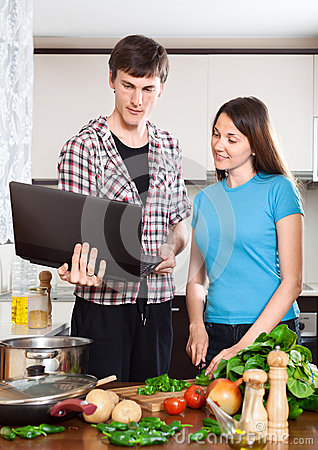 Man shows the new recipe to girl