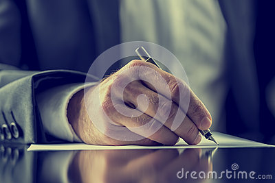 Man signing a document or writing correspondence