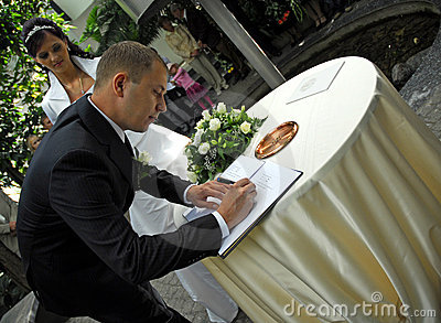 Man signing wedding papers