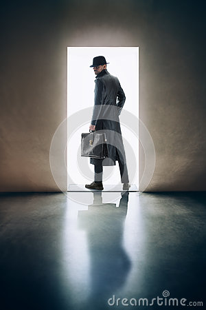Free Man Silhouette Standing In The Light Of Opening Door In Dark Roo Royalty Free Stock Images - 89388009