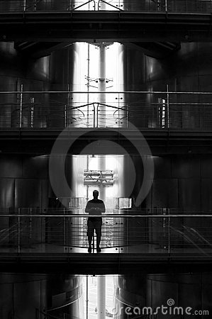 Man silhouetted on balcony