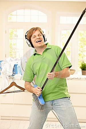 Man singing with broom