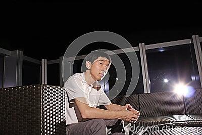 Man sit on a bench