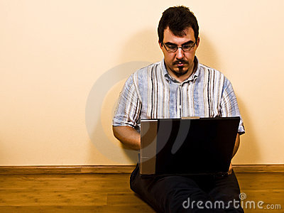 Man sit down work with laptop