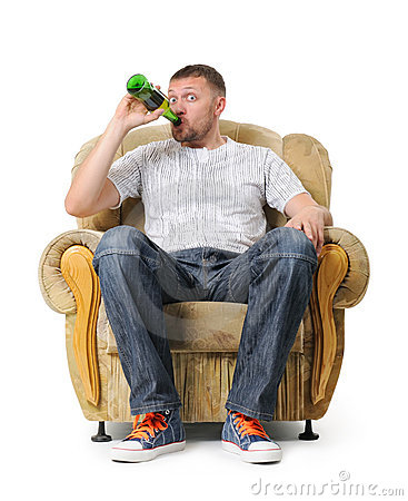 Man sits in an armchair and drinks beer
