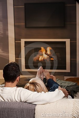 Free Man Sitting At Fireplace Stock Photos - 11677383