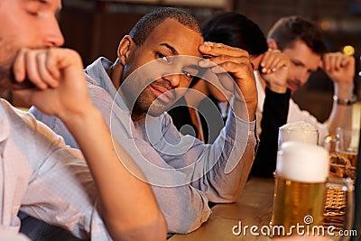 Man sitting at bar counter