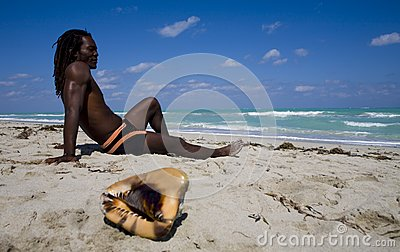 Man sitting on the beach in cuba
