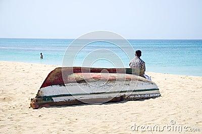 Man sitting on boat.
