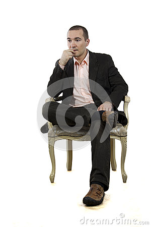 Man sitting in a chair in a pose on a white backgr