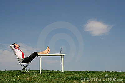 Man sitting at desk, outdoors