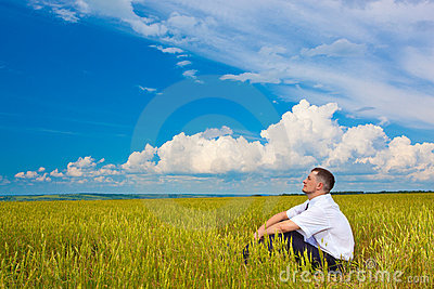 Man sitting on field