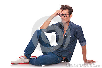 Man sitting on floor & thinking