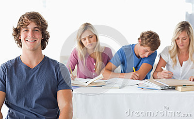 Man sitting in front of his working class mates
