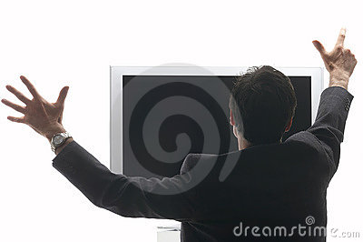 Man sitting in front of a LCD - TV cheering