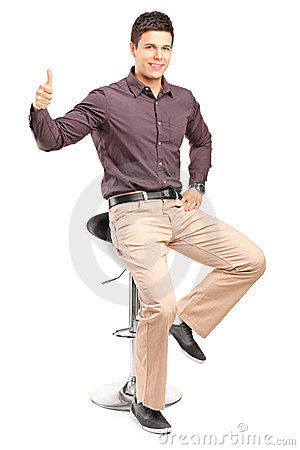 Man sitting on high chair and giving thumb up