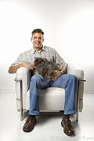 Man sitting holding cat.