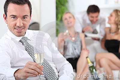 Man sitting holding champagne glass