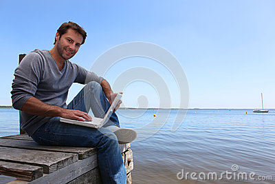 Man sitting on a jetty