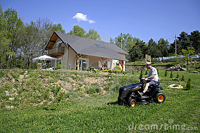 Man sitting on lawnmover