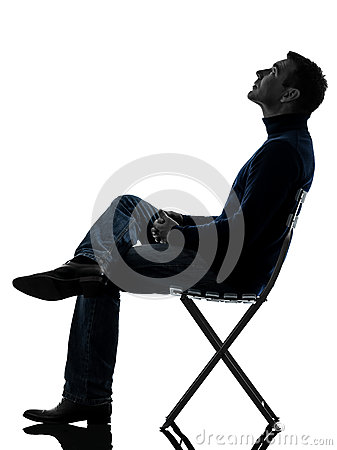 Man sitting looking up  silhouette full length