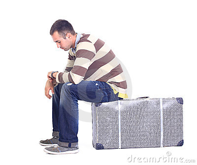 Man sitting on a luggage