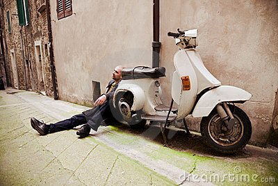 Man Sitting Near Retro Scooter