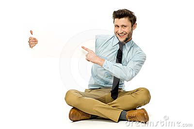 Man sitting and pointing at blank poster