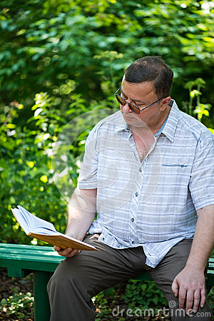 man sitting and reading