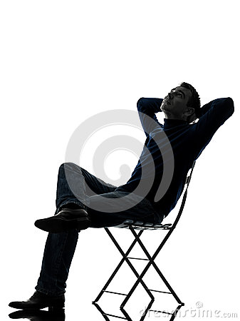 Man sitting resting looking up silhouette full length