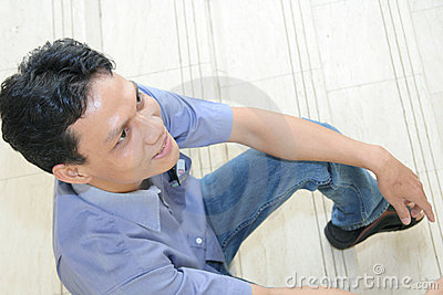 Man sitting on stair