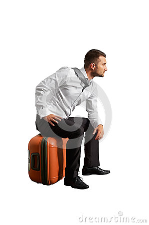 Man sitting on the suitcase