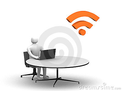 Man sitting at the table and working on a laptop
