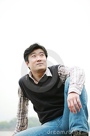 Man sitting on wall