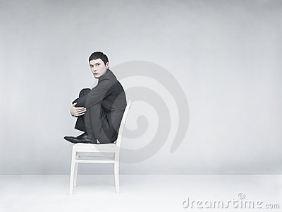 Man sitting on a white stool