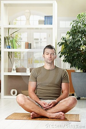 Man sitting in yoga position