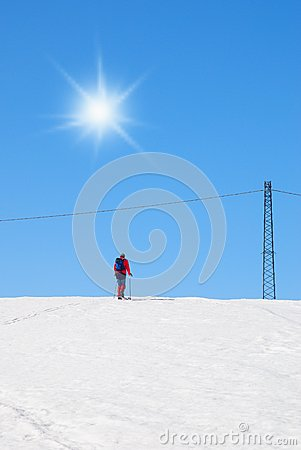 Man with ski on the hill