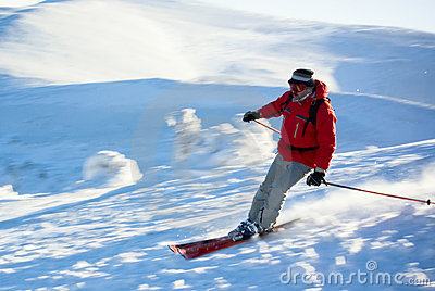 Man skier running down the hill
