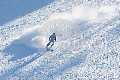 Man is skiing at a ski resort
