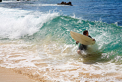 A man skimboarding at Big Beach in Maui