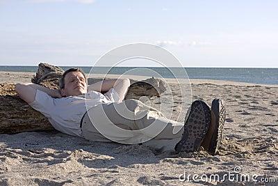 Man sleeping on beach