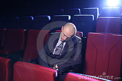 Man sleeping in cinema