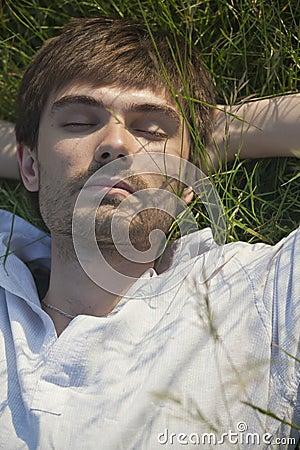 Man sleeping in field