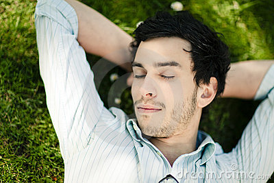 Man Sleeping on Grass