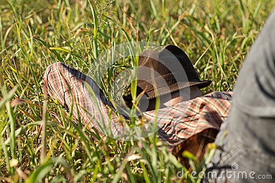 Man sleeping with hat on his face